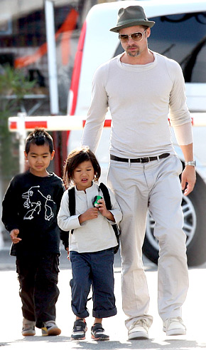 Brad Pitt with sons Maddox and Pax.